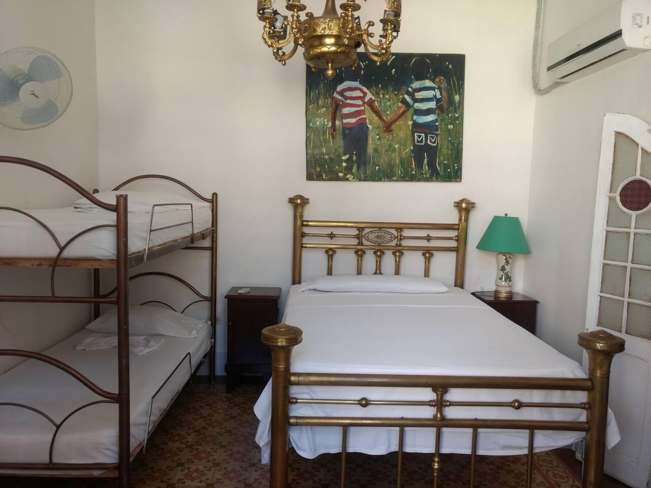CIE002 – Room 3 Quadruple room with private bathroom
